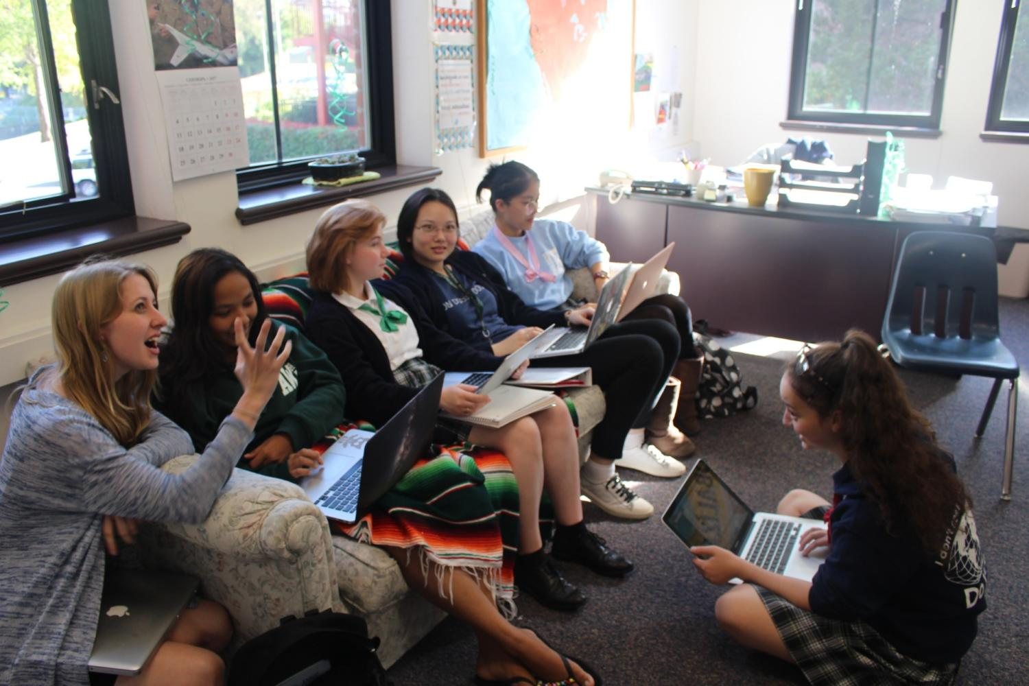 The Model UN activity group plans the details of the debate between the mayoral candidates.
