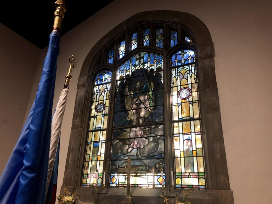 stained glass window over the altar in Raynor Chapel