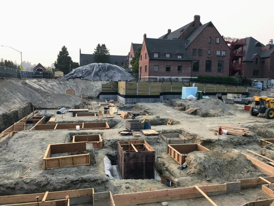 The upper parking lot is currently a building site for the new Upper School for Boys.