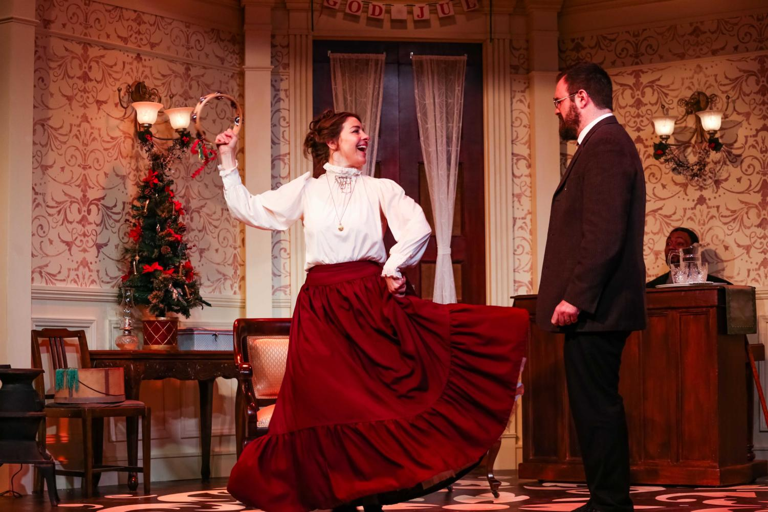 Nora (Annie Green) and Torvald (Sean Neely) in A Doll's House. Photo by Tacoma Little Theater.