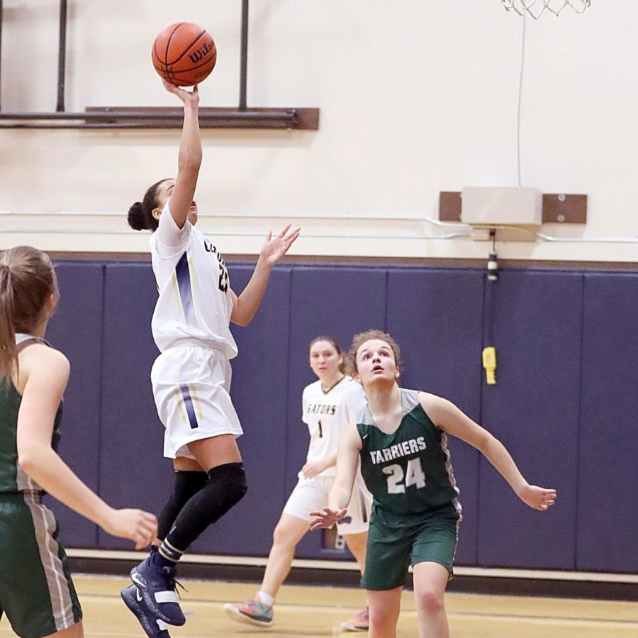 Freshman Jazzy Stone scored the winning two points in the first round of the State tournament today. The Gators won 71-67 and advance to the quarter-finals tomorrow. Photo by Jane Bond.