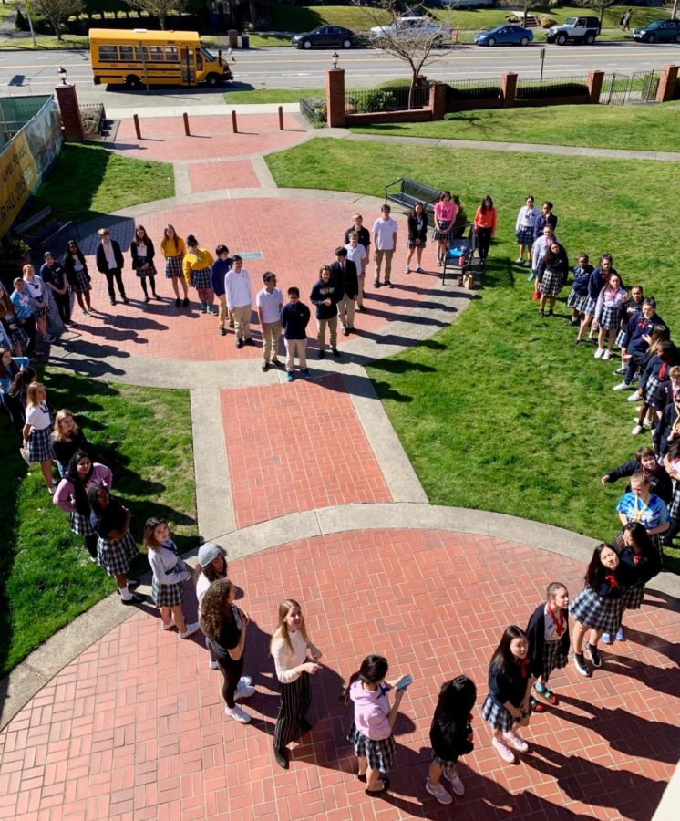 Annie Wright students stand for a video sent to Rangi Ruru, Annie Wright's sister school in Christchurch, New Zealand, to show support after two deadly mass shootings. Photo by Lisa Isenman.