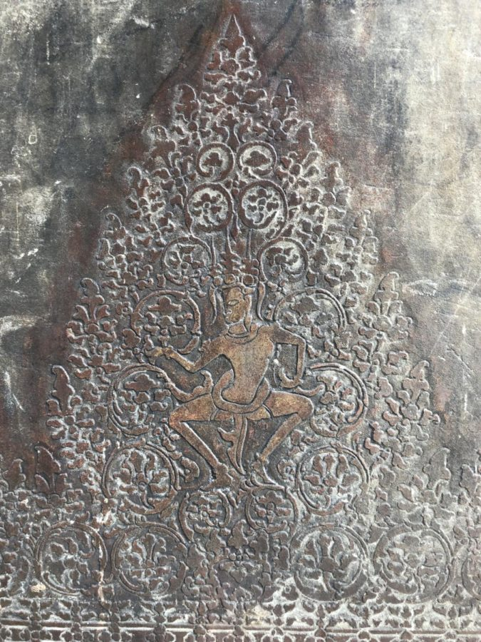The carvings along the walls of Angkor Wat have a noticeable residue of gold.
