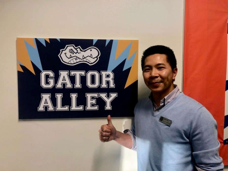 Derek+Zhao+outside+of+the+newly+renamed+Gator+Alley.+%0A