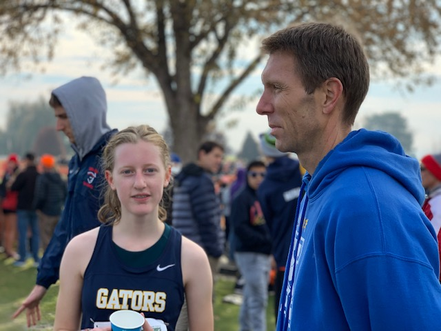 Maxin Pendras with Cross Country coach Troy Droubay.