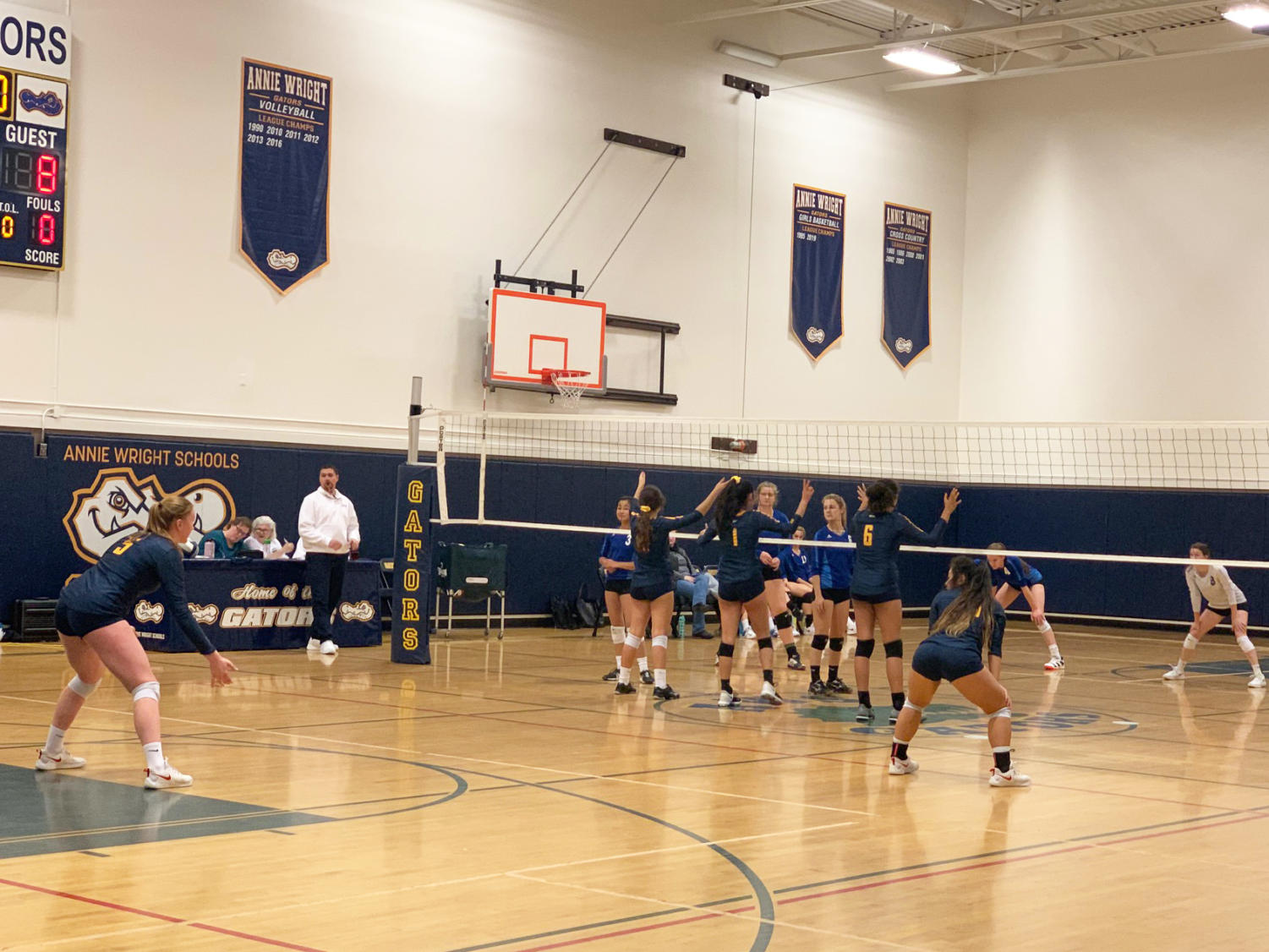 The varsity volleyball team, comprising mostly freshman, advances in districts.