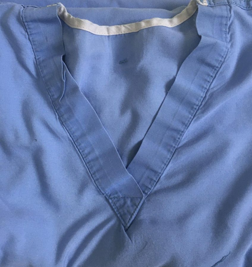 Medical staff wear scrubs, as well as white coats, to ensure no outside contaminants or pathogens are carried via clothing.
