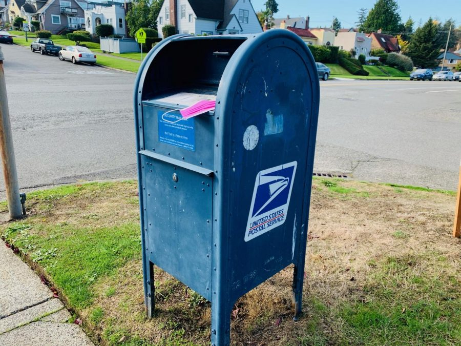 A mask lies on a USPS mailbox near Annie Wright Schools.