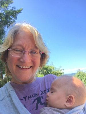 Mrs. Flagg holds her youngest grandchild, Cyrus, after returning to the Pacific Northwest from Washington D.C.