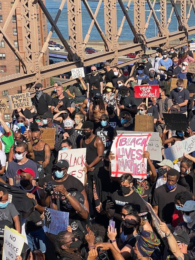 Black Lives Matter protests on the Brooklyn Bridge in New York City, June 9th, 2020. Photo by Stan Wiechers, cropped for sizing and redistributed under Creative Commons Attribution-Share Alike 2.0 Generic License.